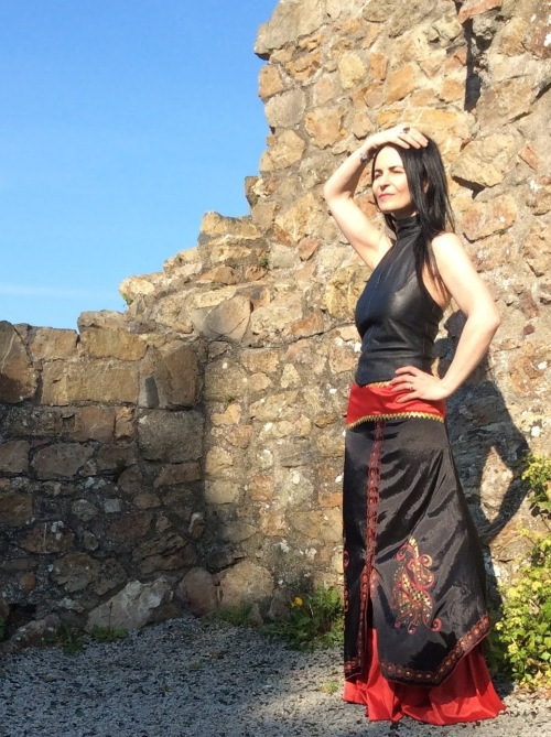 The Indian skirt gives a dramatic vibe.