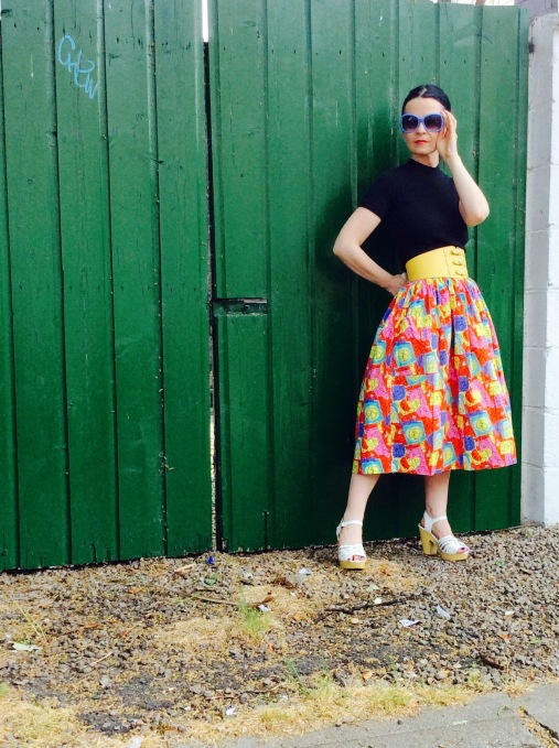 I've worn this fab Vintage Skirt with a black crew neck sweater for an edgy feel!