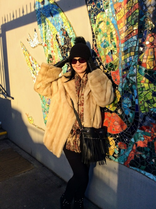 This mink lookalike coat has sumptious wide sleeved fur sleeves. Love!